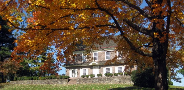 front view of pottsgrove manor in autumn