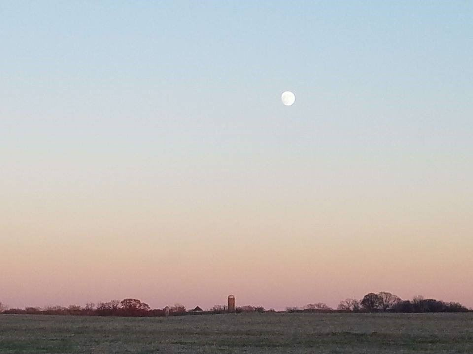 sunset and moon rise over Norristown Farm Park