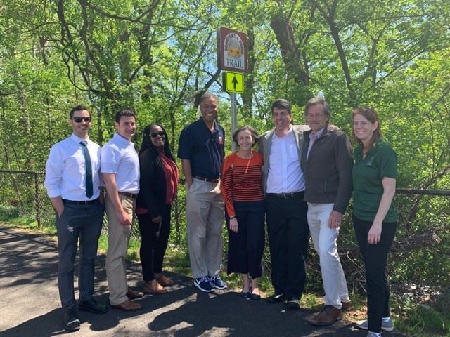Group at trail sign