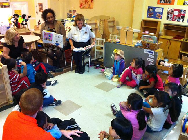 Sheriff Behr reads to Pre K students at Calvary Baptist Children's Learning Center